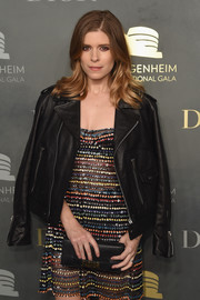 Kate Mara arrived for the 2017 Guggenheim International pre-party wearing a black leather jacket over a sheer, beaded dress.