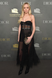 Portia Doubleday toughened up her gauzy dress with pointy black boots, also by Dior.