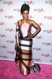 June Ambrose attended the 2017 Hot Pink Party looking diva-ish in a color-block one-shoulder gown.