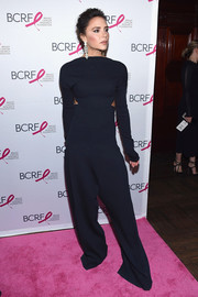 Victoria Beckham attended the 2017 Hot Pink Party wearing a midnight-blue cutout jumpsuit from her own label.