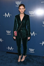 Kate Mara styled her suit with a pair of champagne satin sandals by Jimmy Choo.