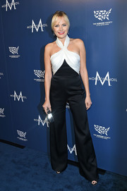 Malin Akerman looked playfully chic in a black-and-white halter jumpsuit by Cristina Ottaviano at the Humane Society of the United States' To the Rescue! Gala.