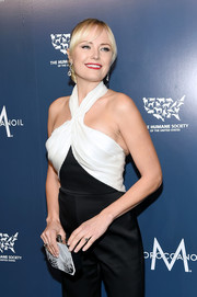 Malin Akerman arrived for the Humane Society of the United States' To the Rescue! Gala carrying a patterned clutch by Simran Rihal.