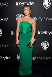 Hilary Duff's gold Lee Savage clutch popped elegantly against her green frock.
