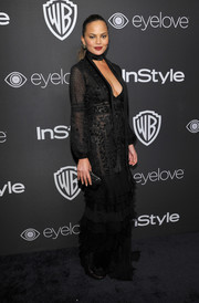 Chrissy Teigen was sultry and sophisticated in a low-cut black ruffle gown by J. Mendel at the InStyle and Warner Bros. Golden Globes post-party.
