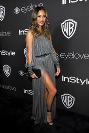 Jamie Chung paired her flirty dress with strappy black heels by Jimmy Choo.