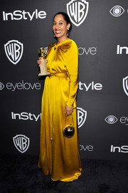 Tracee Ellis Ross looked prim and proper in a long-sleeve marigold silk gown by Paule Ka at the InStyle and Warner Bros. Golden Globes post-party.