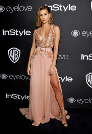 Hailey Baldwin lengthened her pins with a pair of gold platform sandals by Jimmy Choo.