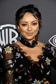 Kat Graham attended the InStyle and Warner Bros. Golden Globes post-party sporting a messy updo with parted bangs.