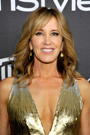 Felicity Huffman framed her face with feathery waves for the InStyle and Warner Bros. Golden Globes post-party.