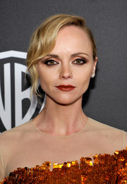 Christina Ricci exuded vintage elegance wearing this finger wave-inspired updo at the InStyle and Warner Bros. Golden Globes post-party.