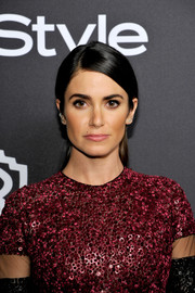 Nikki Reed opted for a simple half-up 'do when she attended the InStyle and Warner Bros. Golden Globes post-party.