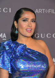 Salma Hayek's gemstone earrings were a perfect complement to her blue sequin dress.