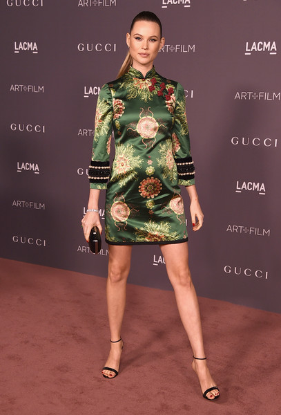 Behati Prinsloo in a satin printed mini dress