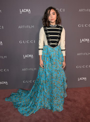 Rowan Blanchard's custom Gucci gown at the 2017 LACMA Art + Film Gala was a play on contrasts with its edgy military-style bodice and flowing print skirt.