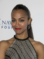 Zoe Saldana accentuated her eyes with some jewel-tone shadow swiped along the lower lash line.