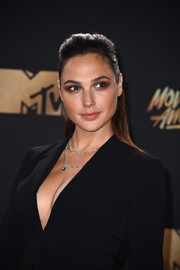 Gal Gadot opted for a simple half-up style when she attended the 2017 MTV Movie and TV Awards.