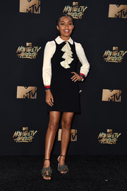 Yara Shahidi went mod in a collared mini dress with ruffle detailing for her turn at the MTV Movie and TV Awards press room.