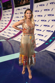 Paris Jackson paired her frock with gold ankle-strap sandals.