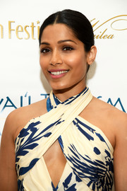 Freida Pinto opted for a simple, classic center-parted bun on day 2 of the 2017 Maui Film Festival.