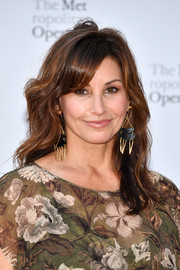Gina Gershon sported a subtly wavy hairstyle with side-swept bangs at the 2017 Metropolitan Opera opening night.