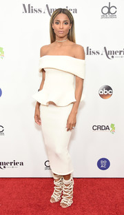 Ciara was trendy and elegant in an off-the-shoulder white peplum top by Julea Domani at the 2017 Miss America competition.