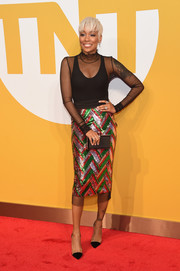 Monica injected major sparkle with a chevron-sequined pencil skirt by Gucci.