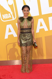 Jada Pinkett Smith worked the sheer trend in a gold Sophie Theallet column dress with a feathered neckline at the 2017 NBA Awards.