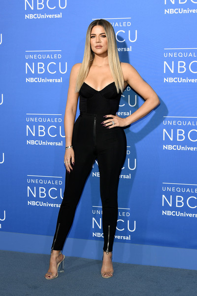 Khloe Kardashian amped up the allure with a pair of zippered skinny pants, also by Versace.