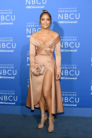 Jennifer Lopez looked perfectly chic in a nude Elie Saab Couture off-the-shoulder dress with a knotted bodice and a high side slit during the 2017 NBCUniversal Upfront.