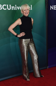 Joanna Coles dressed up her top with a pair of gold trousers.