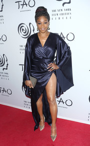 Tiffany Haddish complemented her footwear with a studded clutch.