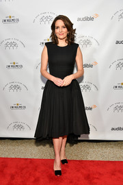 Tina Fey kept it timeless in a little black dress with a fitted bodice and a flared, pleated skirt at the 2017 New York Stage & Film Winter Gala.