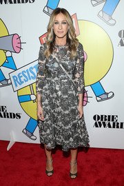 Black open-toe heels with bedazzled ankle straps polished off Sarah Jessica Parker's look.