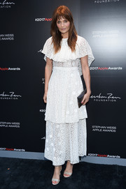 Helena Christensen oozed feminine appeal in a capelet-embellished white lace dress by Stella McCartney at the 2017 Stephan Weiss Apple Awards.