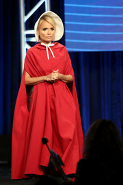Kristin Chenoweth spoke onstage at the TCA Awards looking theatrical in a red cape.
