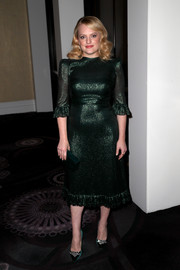 Elisabeth Moss complemented her dress with a pair of bejeweled satin pumps by Jimmy Choo.