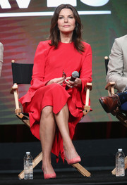 Sela Ward chose a long-sleeve red midi dress for day 1 of the 2017 Summer TCA Tour.