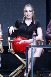Elizabeth Gillies teamed a semi-sheer black polo shirt with a shiny red skirt for the 2017 Summer TCA Tour.