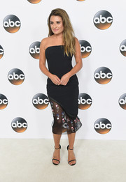 Lea Michele teamed her dress with the iconic Stuart Weitzman Nudist, in black.