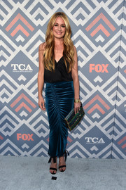 Cat Deeley teamed her top with a ruched teal maxi skirt.