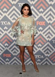 Vanessa Hudgens paired her cute frock with gold slingbacks by Paul Andrew.