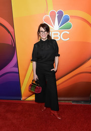 Megan Mullally donned a semi-sheer black blouse with ruffled sleeves for the 2017 Summer TCA Tour.