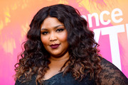 Lizzo framed her face with a center-parted curly 'do for the 2017 Sundance NEXT FEST.