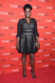 Leslie Jones looked downright elegant in a black lace and chiffon mini dress by Tadashi Shoji at the 2017 Time 100 Gala.
