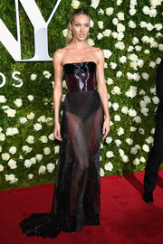 Candice Swanepoel brought a dose of sex appeal to the 2017 Tony Awards with this strapless, sheer-bottom gown by Prabal Gurung.