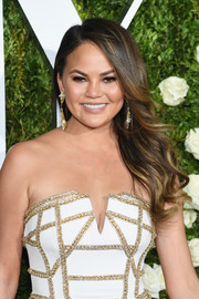 Chrissy Teigen hit the Tonys red carpet wearing her hair in windswept waves.