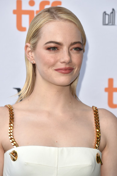 Emma Stone opted for a simple slicked-down straight 'do when she attended the TIFF premiere of 'Battle of the Sexes.'