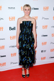 Greta Gerwig teamed her dress with black ankle-strap peep-toes.