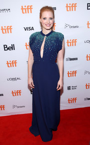 Jessica Chastain looked ultra elegant in a blue Prada gown, featuring a beaded bodice and keyhole detailing, at the TIFF premiere of 'Molly's Game.'
